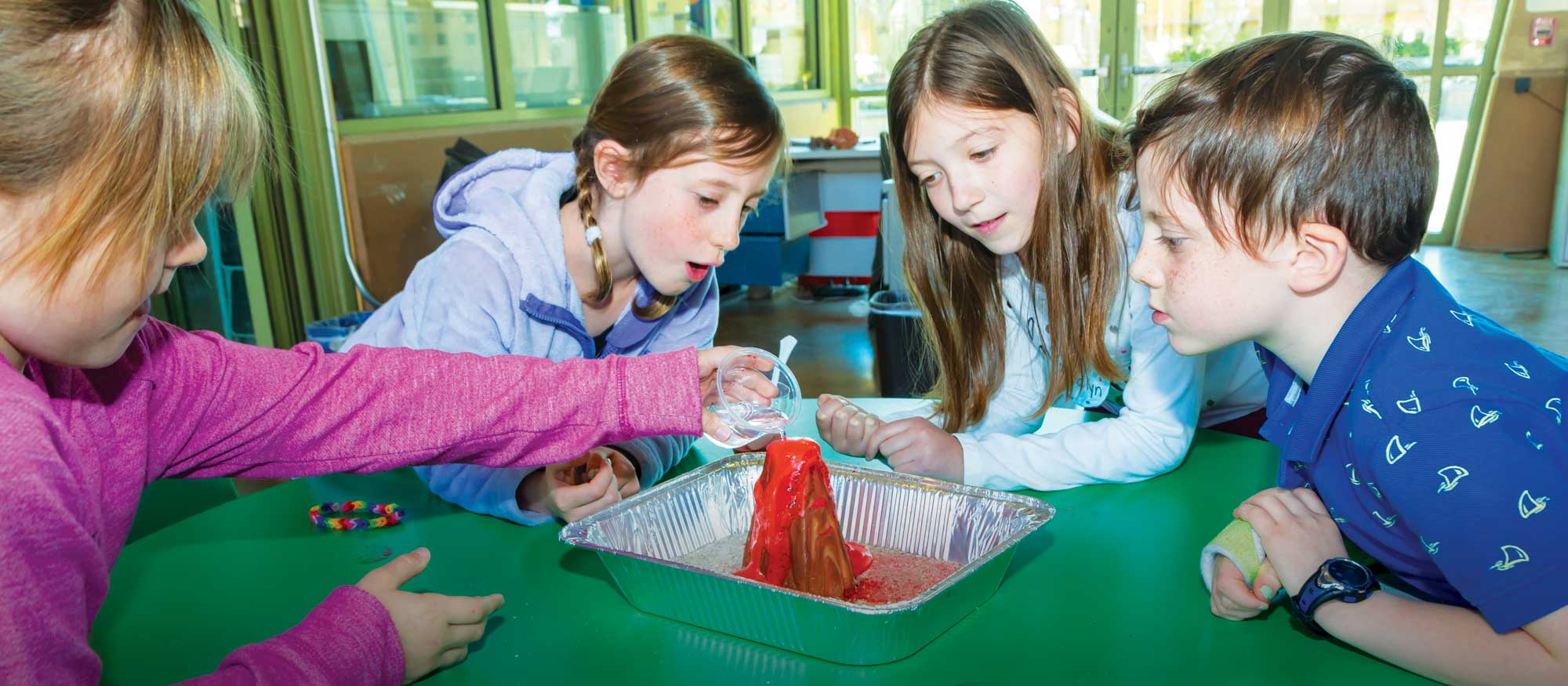 Camp kids work on a science experiment project