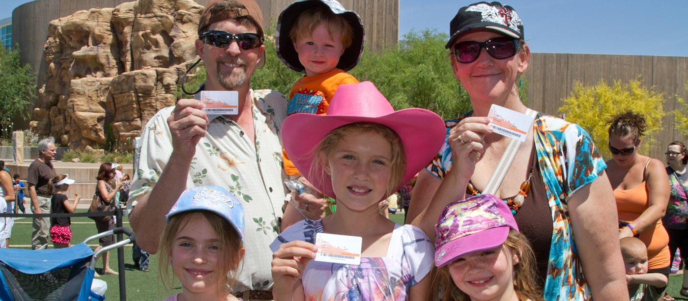 Springs Preserve members showing their membership cards
