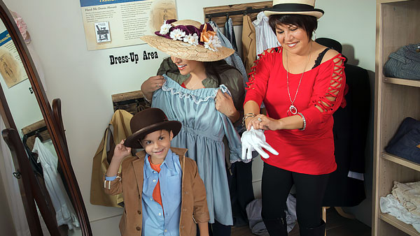 Visitors trying on vintage clothes at the Boomtown 1905 mercantile.