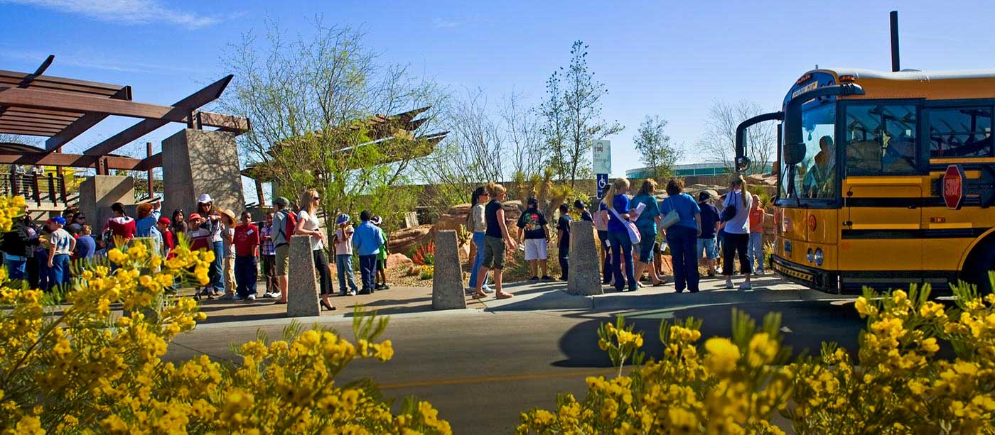 Kids getting off bus in front of the Springs Preserve