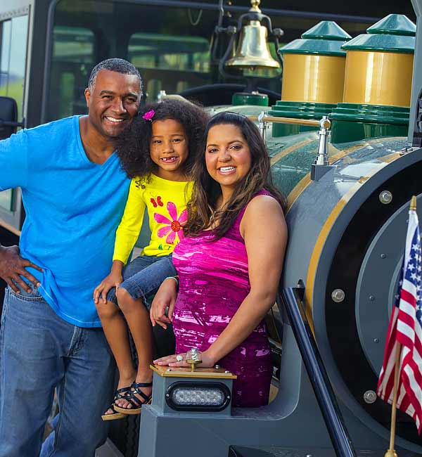 A family posing at the Springs Preserve's trackless train